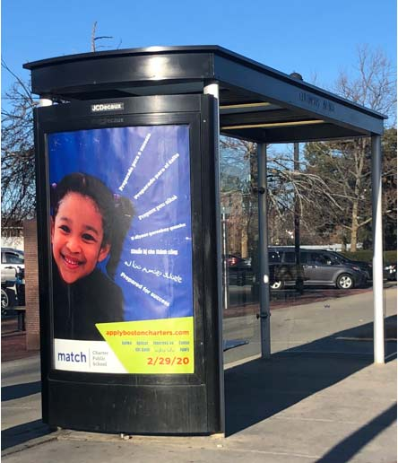 blue poster of child on bus stop sign