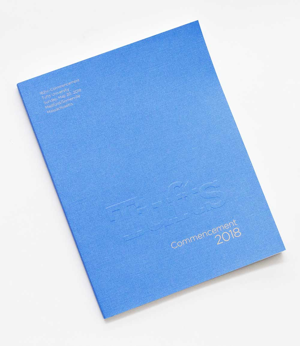 light blue book that says commencement 2018